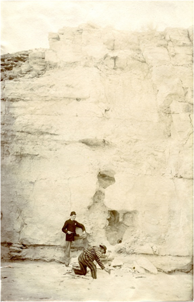 : J.A. Yerington examining footprints.